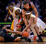 Cal Bear Ayinde Ubaka (cq) has the inside track on a loose ball as he battles Oregon St. Beavers Michael Johnson, top, and Marcel Jones, left, during first half of first round game of the Pac 10 Basketball Tournament at the Staples Center in Los Angeles, Wednesday March 07, 2007. Cal's Patrick Christopher is at left..