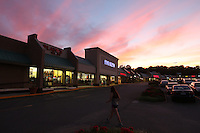 The Rio Hill Shopping Center at sunset in Charlottesville, Va. Photo/Andrew Shurtleff