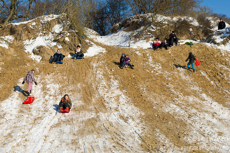 sledding on the dunes of the Netherlands.