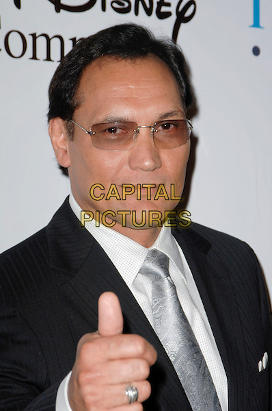 JIMMY SMITS .arriving at the 24th Annual Imagen Awards Honoring Latinos in the Entertainment Industry at the Beverly Hilton Hotel in Beverly Hills, California, USA, August 21st 2009. .portrait headshot glasses silver tie white shirt black hand gesture thumb up ring .CAP/ROT.©Lee Roth/Capital Pictures