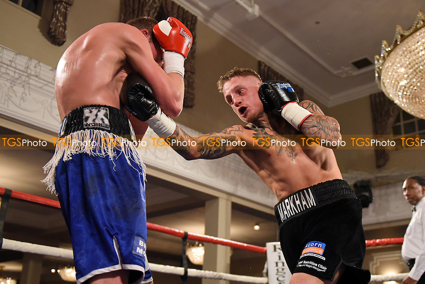 Lee Markham (R) defeats Dan Blackwell during a Boxing show at the Prince Regent Hotel, Chigwell, Essex