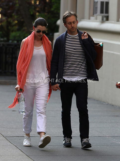 WWW.ACEPIXS.COM<br /> <br /> May 6 2015, New York City<br /> <br /> Actress Anne Hathaway and her husband Adam Shulman walk in the East Village on May 6 2015 in New York City<br /> <br /> By Line: Zelig Shaul/ACE Pictures<br /> <br /> <br /> ACE Pictures, Inc.<br /> tel: 646 769 0430<br /> Email: info@acepixs.com<br /> www.acepixs.com