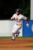 Second baseman Yoan Moncada (24) of the Greenville Drive runs toward third in a game against the Charleston RiverDogs on Monday, June 29, 2015, at Fluor Field at the West End in Greenville, South Carolina. The Cuban-born 19-year-old Red Sox signee has been ranked the No. 1 international prospect in baseball by Baseball America. Greenville won, 4-2. (Tom Priddy/Four Seam Images)
