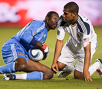 LA Galaxy defender Leonardo (22) attends to goal keeper Donovan Ricketts (1) save. The LA Galaxy defeated the Philadelphia Union 1-0 at Home Depot Center stadium in Carson, California on  April  2, 2011....