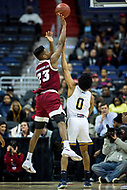 Washington, DC - MAR 7, 2018: Massachusetts Minutemen guard C.J. Anderson (23) shoots a jump shot over La Salle Explorers guard Pookie Powell (0) in game between La Salle and UMass during first round action of the Atlantic 10 Basketball Tournament at the Capital One Arena in Washington, DC. (Photo by Phil Peters/Media Images International)
