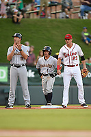 Third baseman Jose Carrera (1) of the Charleston RiverDogs stands on third base between Manager Patrick Osborn (13) and Bobby Dalbec (23) of the Greenville Drive in Game 2 of the South Atlantic League Southern Division Playoff on Friday, September 8, 2017, at Fluor Field at the West End in Greenville, South Carolina. Charleston won, 2-1, and the series is tied at one game each. (Tom Priddy/Four Seam Images)
