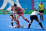 Michelle Vittese #9 of United States is tackled by Pia-Sophie Oldhafer #29 of Germany during USA vs Germany in a women's quarterfinal game at the Rio 2016 Olympics at the Olympic Hockey Centre in Rio de Janeiro, Brazil.