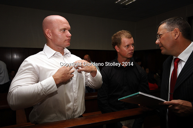 DURBAN - 10 March 2014 -  Four men -- Blayne Shepard (left) and his brother Kyle Shepard (center) speak to their lawyer Jacques Botha in the Durban Regional Court where they face charges related to the fatal beating of former Royal Marine Brett Williams at Kings Park Stadium following a Super Rugby XV match in March 2013. Picture: Allied Picture Press/APP