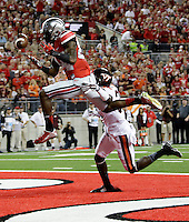 Ohio State Buckeyes wide receiver Corey Smith (84) can't catch a pass in the end zone as he is defended by Virginia Tech Hokies cornerback Brandon Facyson (31) during Saturday's NCAA Division I football game between the Ohio State Buckeyes and the Virginia Tech Hokies at Ohio Stadium in Columbus on September 6, 2014. Virginia Tech led at halftime, 21-7. (Dispatch Photo by Barbara J. Perenic)