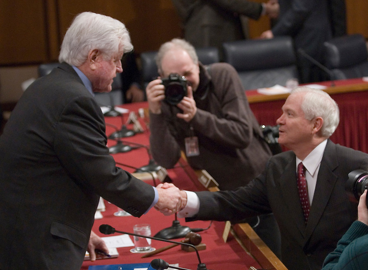 Defense Secretary Robert Gates speaks with Sen. Ted Kennedy, D-Mass., before the start of the Senate Armed Services Committee hearing on Iraq on Friday, Jan. 12, 2007.
