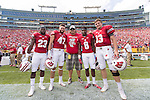 Wisconsin Badgers honorary captain Mark Tauscher, center, with captains Dare Ogunbowale (23) Vince Biegel (47), Sojourn Shelton (8) and Bart Houston (13) prior to an NCAA college football game against the LSU Tigers Saturday, September 3, 2016, in Green Bay, Wis. The Badgers beat the Tigers 16-14. (Photo by David Stluka)