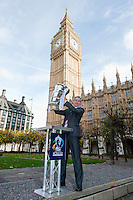 PICTURE BY ALEX BROADWAY/SWPIX.COM - Rugby League - RLWC2013 - Rugby League World Cup Parliament Visit - Westminster, London, England  - 31/10/12 - MP's have their photograph taken with the Rugby League World Cup outside the Houses of Parliament. Greg Mulholland.