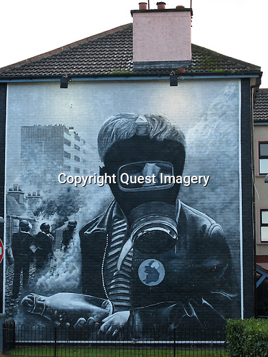 A mural called &quot;Petrol Bomber&quot; showing a young boy with a gas mask and petrol bomb depicting the Battle of the Bogside, as part of a series of murals called &quot;The People's Gallery&quot; in the Bogside, a neighborhood outside the city walls of Derry, Northern Ireland. The area has been a focus point for many of the events of &quot;The Troubles&quot;.<br />