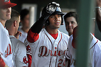 Second baseman Yoan Moncada (24) of the Greenville Drive is congratulated after scoring in a game against the Greensboro Grasshoppers on Wednesday, August 26, 2015, at Fluor Field at the West End in Greenville, South Carolina. The Cuban-born 19-year-old Red Sox signee has been ranked the No. 1 international prospect in baseball by Baseball America. Greenville won, 7-0. (Tom Priddy/Four Seam Images)