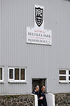 Two club officials standing at the players entrance at the back of the main stand at Bellslea Park, home of Fraserburgh FC, prior to the club's Highland League fixture against visitors Strathspey Thistle. Nicknamed 'The Broch,' Fraserburgh have been members of the Highland League since 1921 having been formed 11 years earlier. The match ended in a 2-2 draw in front of a crowd of 302.