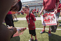 NWA Democrat-Gazette/J.T. WAMPLER Sloan Cook, 6, gets an autograph from Arkansas running back Rawleigh Williams III Sunday Aug. 16, 2015 during 2015 UA Fan Day at Donald W. Reynolds Razorback Stadium in Fayetteville. Several hundred fans attended the annual event to get close up to Razorback football players and coaches to get autographs and photographs.