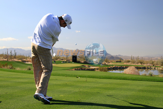 Ross Fisher tees off on the par 3 3rd tee during Day 2 of the Accenture Match Play Championship from The Ritz-Carlton Golf Club, Dove Mountain. (Photo Eoin Clarke/Golffile 2011)