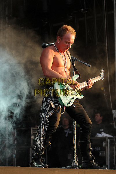 DEF LEPPARD - Phil Collen.Download Festival 2009 - Day Three.Donington Park, Derbyshire, England..June 14th, 2009.stage concert live gig performing performance music full length guitar chest jeans denim .CAP/BRC.©Ben Rector/Capital Pictures.