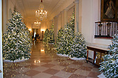 "The 2017 White House Christmas decorations, with the theme ""Time-Honored Traditions,"" which were personally selected by first lady Melania Trump, are previewed for the press in Washington, DC on Monday, November 27, 2017.  This is the Cross Hall looking from the East Room to the State Dining Room.<br /> Credit: Ron Sachs / CNP"