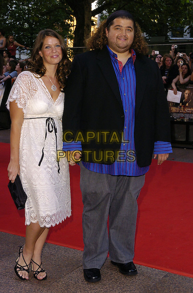 "JORGE GARCIA & GUEST.At the Premiere of ""Pirates Of The Carribean 2: Dead Man's Chest"", Odeon Leicester Square, London,.July 3rd 2006..full length holding hands lost blue shirt.Ref: CAN.www.capitalpictures.com.sales@capitalpictures.com.©Can Nguyen/Capital Pictures"