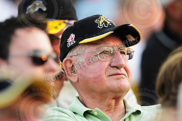 June 26, 2008; Hamilton, ON, CAN; Hamilton Tiger-Cats supporter. CFL football - Montreal Alouettes defeated the Hamilton Tiger-Cats 33-10 at Ivor Wynne Stadium. Mandatory Credit: Ron Scheffler-www.ronscheffler.com. Copyright (c) Ron Scheffler