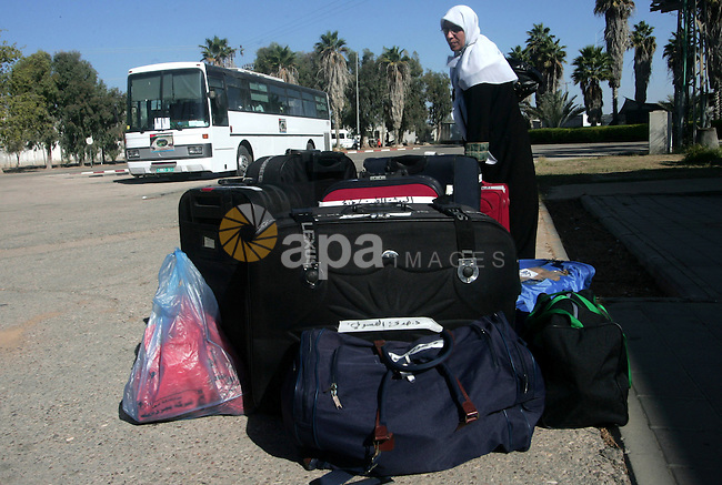 Palestinian pilgrims prepare their bags as they wait to cross the Rafah border crossing into Egypt , in the southern Gaza Strip town of Rafah on Nov. 3,2010 . Hundreds of Palestinian pilgrims crossed into Egypt on their way to Saudi Arabia to perform the annual Muslim Hajj pilgrimage. Photo by Khaled Khaled
