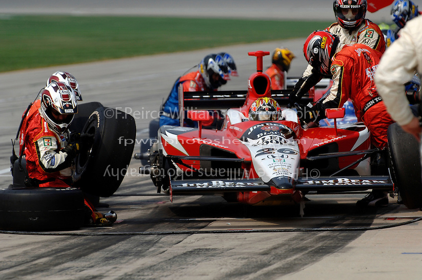 11 September, 2005, Joliet,IL,USA<br /> Dan Wheldon makes his first pit stop.<br /> Copyright&copy;F.Peirce Williams 2005