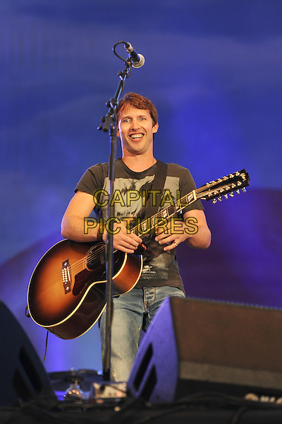 James Blunt.At BBC Radio 2 Live in Hyde Park, London, England..September 11th, 2011.stage concert live gig performance music half length black t-shirt guitar 3/4.CAP/MAR.© Martin Harris/Capital Pictures.