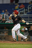 Batavia Muckdogs catcher J.D. Osborne (23) follows through on a swing during a game against the West Virginia Black Bears on June 18, 2018 at Dwyer Stadium in Batavia, New York.  Batavia defeated West Virginia 9-6.  (Mike Janes/Four Seam Images)