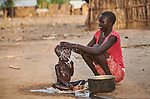 Hawula Abdu bathes her son in the Doro Refugee Camp in Maban County, South Sudan. Doro is one of four camps in Maban that together shelter more than 130,000 refugees from the Blue Nile region of Sudan. Jesuit Refugee Service provides educational and psycho-social services to both refugees and the host community. <br /> <br /> Misean Cara supports the work of JRS in the Maban camps.