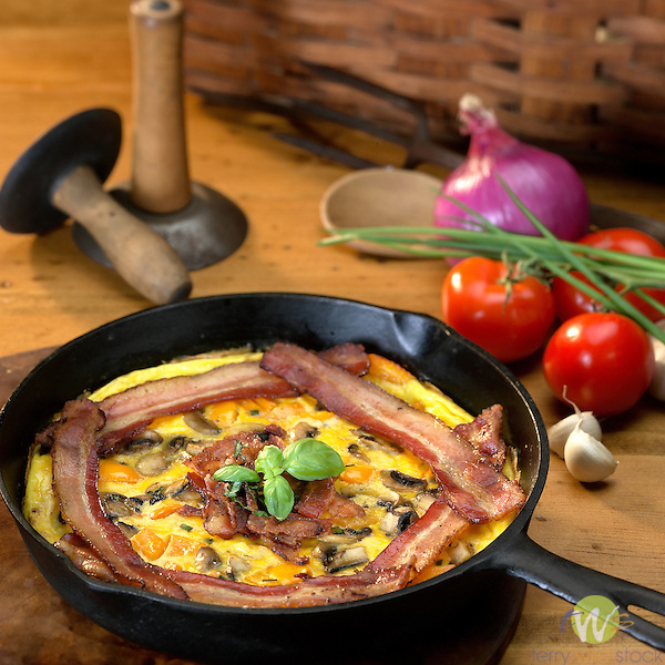 Country Store meat products. Bacon and omlette in skillet.
