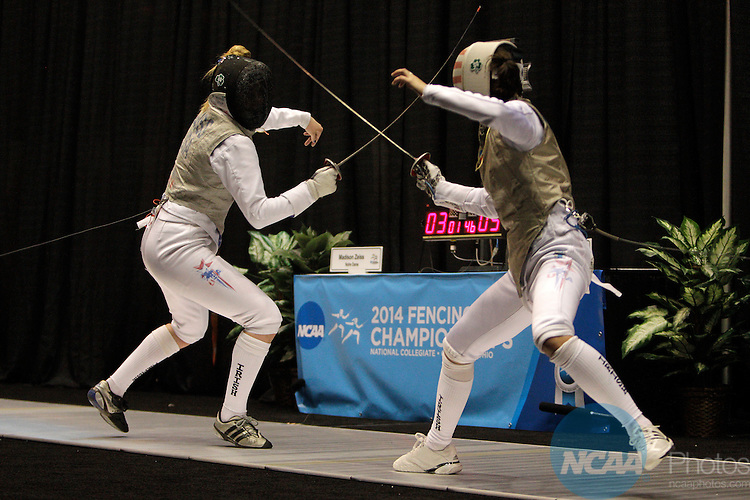 21 MAR 2014: Madison Zeiss, left, of Notre Dame fences against Lee Kiefer, of Notre Dame, in the foil event finals during the Division I Women's Fencing Championship held at St. John Arena on the Ohio State University campus in Columbus, OH. Kiefer won the championship by a score of 13-10. Jay LaPrete/NCAA Photos