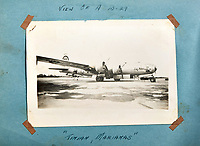 BNPS.co.uk (01202 558833)<br /> AndreasThies/BNPS<br /> <br /> Picture: The B-29 on a runway at Tinian, Marianas.<br /> <br />  Never-before-seen photos of the aircraft crew that dropped the world's first atomic bomb receiving a heroes' welcome upon returning from the historic mission have come to light.<br /> <br /> The black and white images show the 12 airmen posing for photos moments after the B-29 bomber 'Enola Gay' arrived back at base in the wake of the devastating attack on Hiroshima in Japan.<br /> <br /> One photo is of pilot Colonel Paul Tibbets being given an immediate gallantry decoration by a general after stepping off the aircraft.<br /> <br /> The album, containing 88 images, was collated by a US airman serving on the base during World War Two.