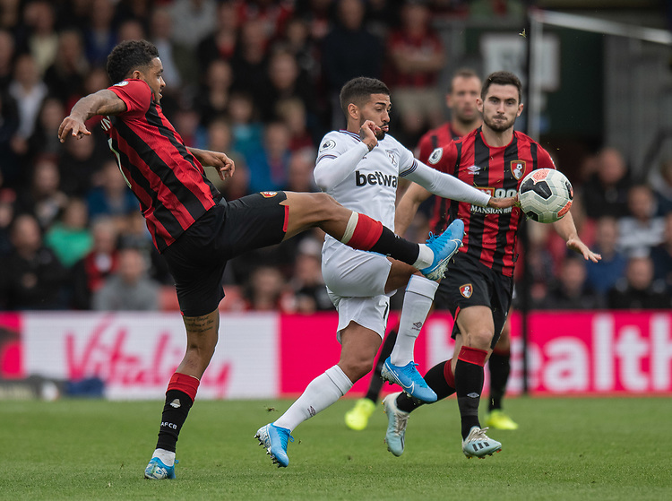 West Ham United's Manuel Lanzini (centre) battles for possession with Bournemouth's Joshua King (left) <br /> <br /> Photographer David Horton/CameraSport<br /> <br /> The Premier League - Bournemouth v West Ham United - Saturday 28th September 2019 - Vitality Stadium - Bournemouth<br /> <br /> World Copyright © 2019 CameraSport. All rights reserved. 43 Linden Ave. Countesthorpe. Leicester. England. LE8 5PG - Tel: +44 (0) 116 277 4147 - admin@camerasport.com - www.camerasport.com