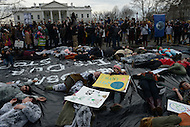 Washington, DC - March 2, 2014: Protestors simulate the potential destruction a large oil spill in front of the White House March 2, 2014 to protest the Keystone XL Pipeline. Police later arrested a large group of protestors who zip-tied themselves to the White House fence and refused to move from the sidewalk.  (Photo by Don Baxter/Media Images International)