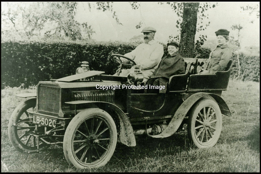 BNPS.co.uk (01202 558833)<br /> Pic: Bonhams/BNPS<br /> <br /> ****Please use full byline****<br /> <br /> Bernhart family outing in 1910.<br /> <br /> An ancient car that has been owned by the same family for so long nobody can remember what make it actually is has been put up for auction by an elderly woman whose grandfather bought it in 1908.<br /> <br /> The mystery motor dates back to 1903 but there are no surviving documents to confirm what the make and model of it are and the man who first bought it is long dead.<br /> <br /> In the earliest days of motoring there were many different manufacturers that sprang up to try their hand at the new technology, and it appears that this sturdy machine has long outlasted the company that made it.<br /> <br /> Despite its dubious origin the vehicle is still expected to sell for &pound;160,000.