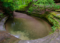 The plunge pool in LaSalle Canyon has carved a bowl in the soft sandstone rock, Starved Rock State Park, LaSaalle County, Illinois