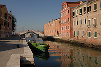 Rubbish collected in Venice by barge from narrow canals in residential areas, Venice, Italy, May 2007