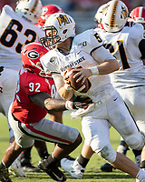 ATHENS, GA - SEPTEMBER 7: Murray State quarterback Preston Rice #5 tries to elude the rush of Justin Young #92 during a game between Murray State Racers and University of Georgia Bulldogs at Sanford Stadium on September 7, 2019 in Athens, Georgia.