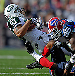 30 September 2007: Buffalo Bills cornerback Kiwaukee Thomas tackles New York Jets wide receiver Laveranues Coles at Ralph Wilson Stadium in Orchard Park, NY. The Bills defeated the Jets 17-14 for their first win of the 2007 season...Mandatory Photo Credit: Ed Wolfstein Photo