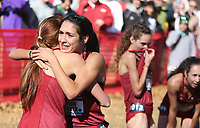 NWA Democrat-Gazette/DAVID GOTTSCHALK University of Arkansas Cross Country runner Taylor Werner receives a hug from teammates at the finish Friday, November 15, 2019, at the NCAA South Regional at the Agri Park course in Fayetteville. Werner won the overall individual title and the Razorback women won the overall team title.