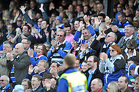 Bath fans in the crowd celebrate the match-winning try. Aviva Premiership match, between Bath Rugby and Leicester Tigers on April 20, 2013 at the Recreation Ground in Bath, England. Photo by: Patrick Khachfe / Onside Images