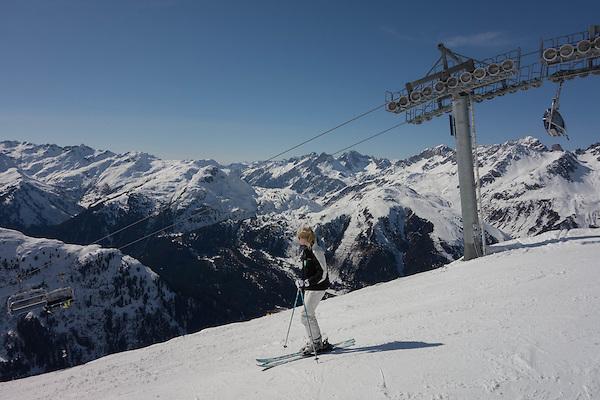 Woman skiing at Rendl Ski Area at St Anton, Austria,