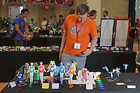 OrigamiUSA Convention 2015 Exhibition. Models designed and folded by Michelle Fung, CA. Mark Bailey, MD, views the exhibition.