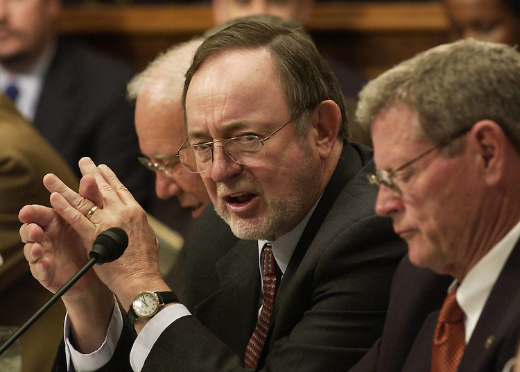 "7/7/04.TRANSPORTATION REAUTHORIZATION--During the meeting of House and Senate conferees to consider legislation that would reauthorize surface transportation, House Transportation Chairman Don Young, R-Alaska, far left, responds to a statement by Sen. Harry Reid, D-Nev., predicting that no transportation bill will come out of the conference, and that Young has ""lost his pizzazz."" Senate Committee on Environment and Public Works Chairman James M. Inhofe, R-Okla., looks on. .CONGRESSIONAL QUARTERLY PHOTO BY SCOTT J. FERRELL"