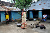 Monika Besra (42) and her family at their house at Danagram, a village 40 kms away from Malda Town,  West Bengal, India. 20th August 2010.  Monica Besra says that her non curable tumour got cured on the first annivarsary of Mother Teresa's death by putting a Mother Teressa Medellion on the swollen part of her abdomen, which was recognized by the Vatican in the year 2002 and started the process of Mother Teresa's beatification, a major step towards sainthood.