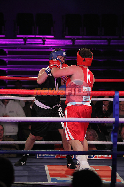 "Graham Hughes ""Thee President"" (black) sponsored by Outsource and Mark ""Bone Crusher"" McGowan (red) sponsored by Scholars Townhouse Hotel taking part in Drogheda and District, ""Battle of the Barbican"" White Collar Boxing Event in aid of the Des Smyth Foundation...(Photo credit should read Jenny Matthews www.newsfile.ie)....This Picture has been sent you under the conditions enclosed by:.Newsfile Ltd..The Studio,.Millmount Abbey,.Drogheda,.Co Meath..Ireland..Tel: +353(0)41-9871240.Fax: +353(0)41-9871260.GSM: +353(0)86-2500958.email: pictures@newsfile.ie.www.newsfile.ie."