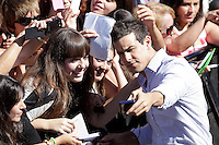 "Actor Mario Casas signs autographs and posses during the presentation of ""Las brujas de Zugarramurdi"" in the 61 San Sebastian Film Festival, in San Sebastian, Spain. September 22, 2013. (ALTERPHOTOS/Victor Blanco) /NortePhoto"