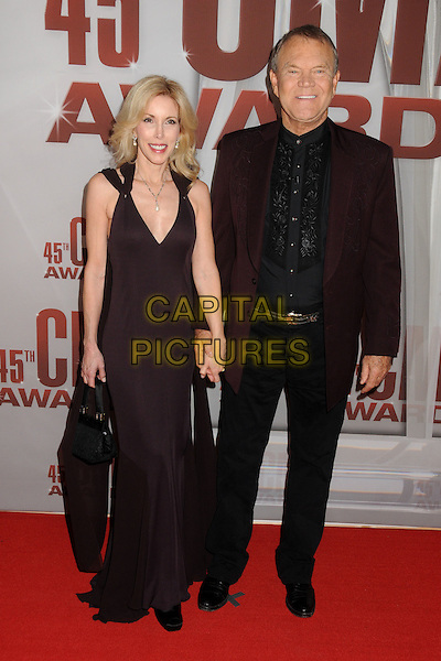 guest & Glen Campbell.The 45th Annual CMA Awards, Country Music's Biggest Night, held at Bridgestone Arena, Nashville, Tennessee, USA..November 9th, 2011.full length dress suit black.CAP/ADM/BP.©Byron Purvis/AdMedia/Capital Pictures.
