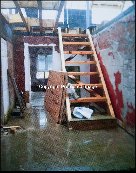 BNPS.co.uk (01202 558833)<br /> Pic: PhilYeomans/BNPS<br /> <br /> Flooded ground floor after much rain.<br /> <br /> Plucky Carol Sullivan turned a £160,000 black hole left by cowboy builders into one million pound house - after building her dream home herself.<br /> <br /> Carol was left severley out of pocket after her luxury home was built with sub-standard mortar - meaning the whole structure had to be pulled down when the project was half way through.<br /> <br /> After firing the builders and waving goodbye to £160,000, undaunted Carol(50) enrolled on a bricklaying course at her local college and learned how to build the house herself. <br /> <br /> Further courses in carpentry and plumbing  have enabled determined Carol to complete the project in a year. The house is now thought to worth £1 million.